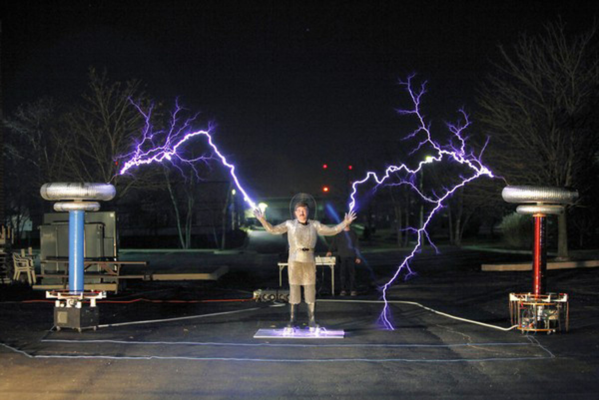 Tesla coil enthusiasts danger and drama part of allure terry blake watches from a distance as jeff larson and steve ward test the electricity between two tesla coils sciox Choice Image